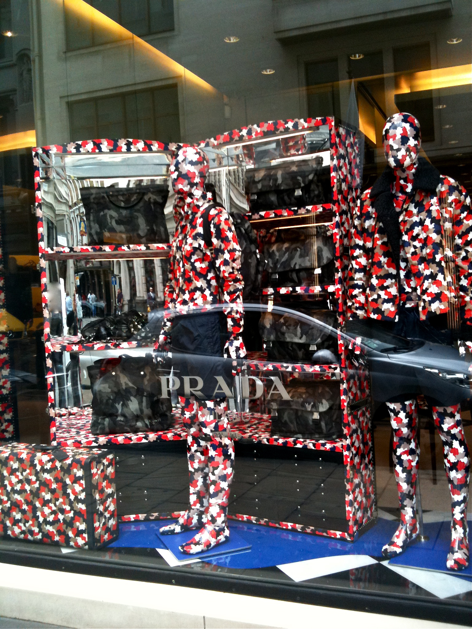 c2d706f2f5f8 Camouflage window display at Prada for winter 2010