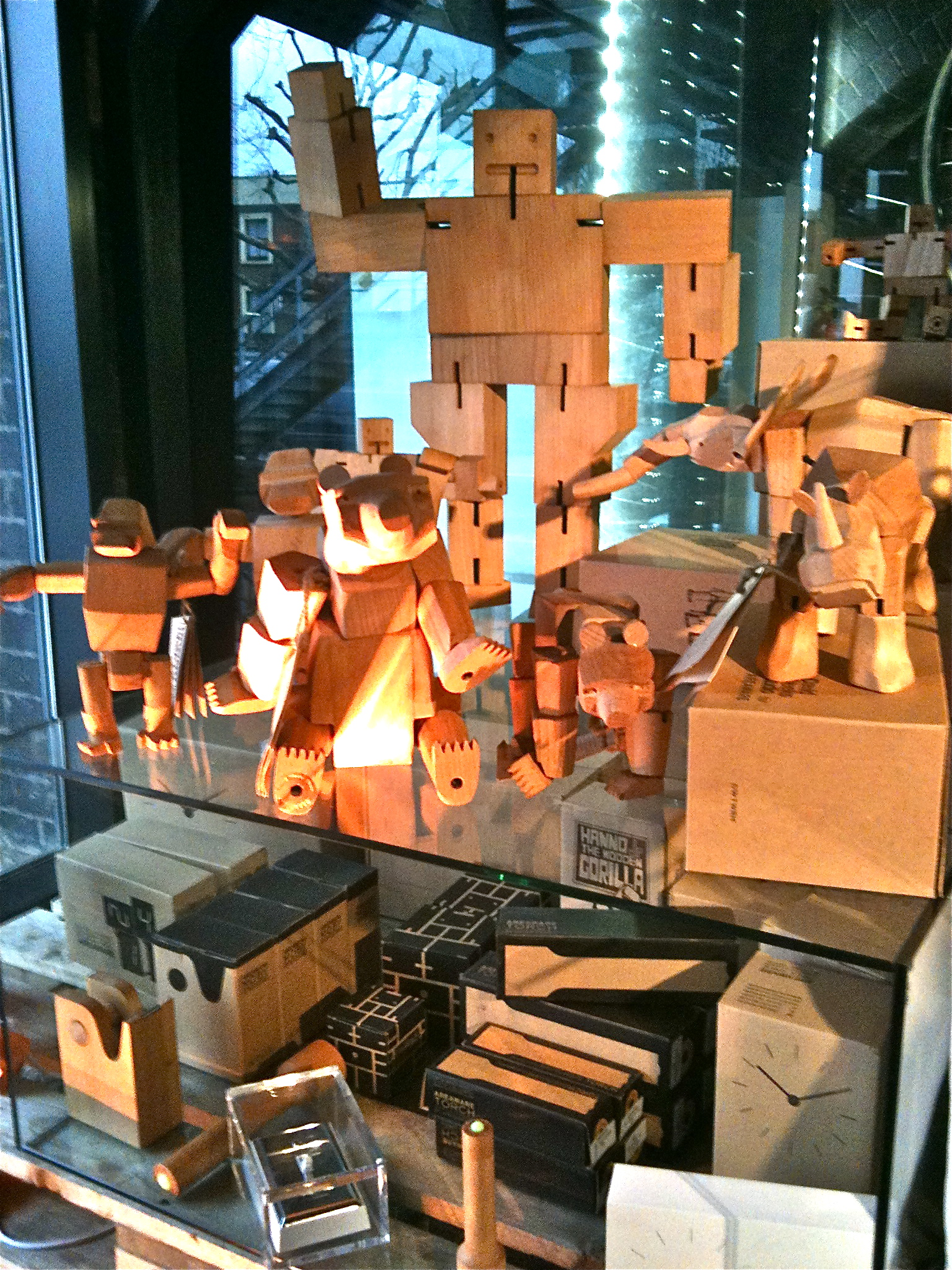 Wooden robots and animals in the Tom Dixon shop by Areaware
