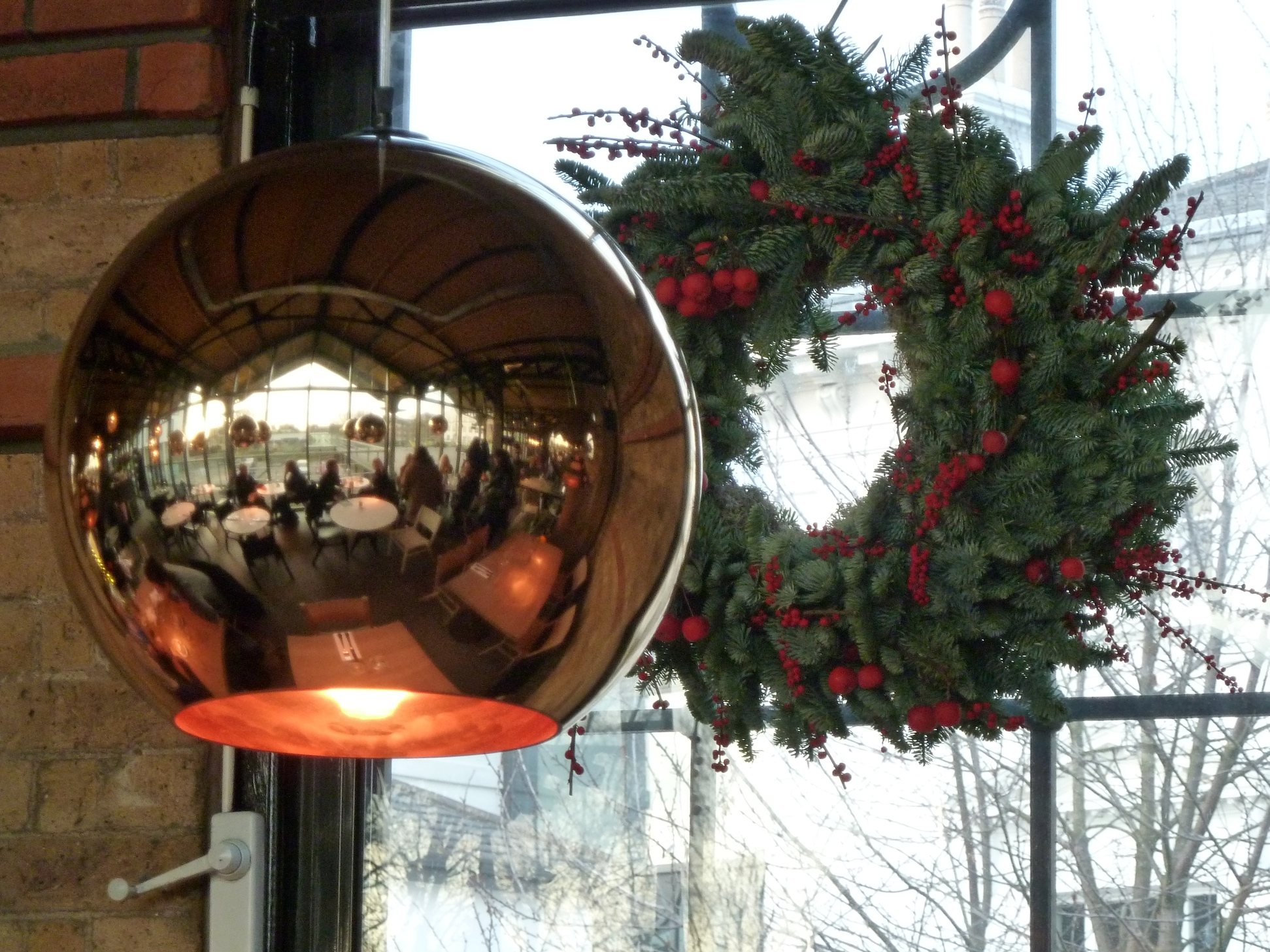 The Dock Kitchen restaurant reflected in dome copper light at Portobello Dock