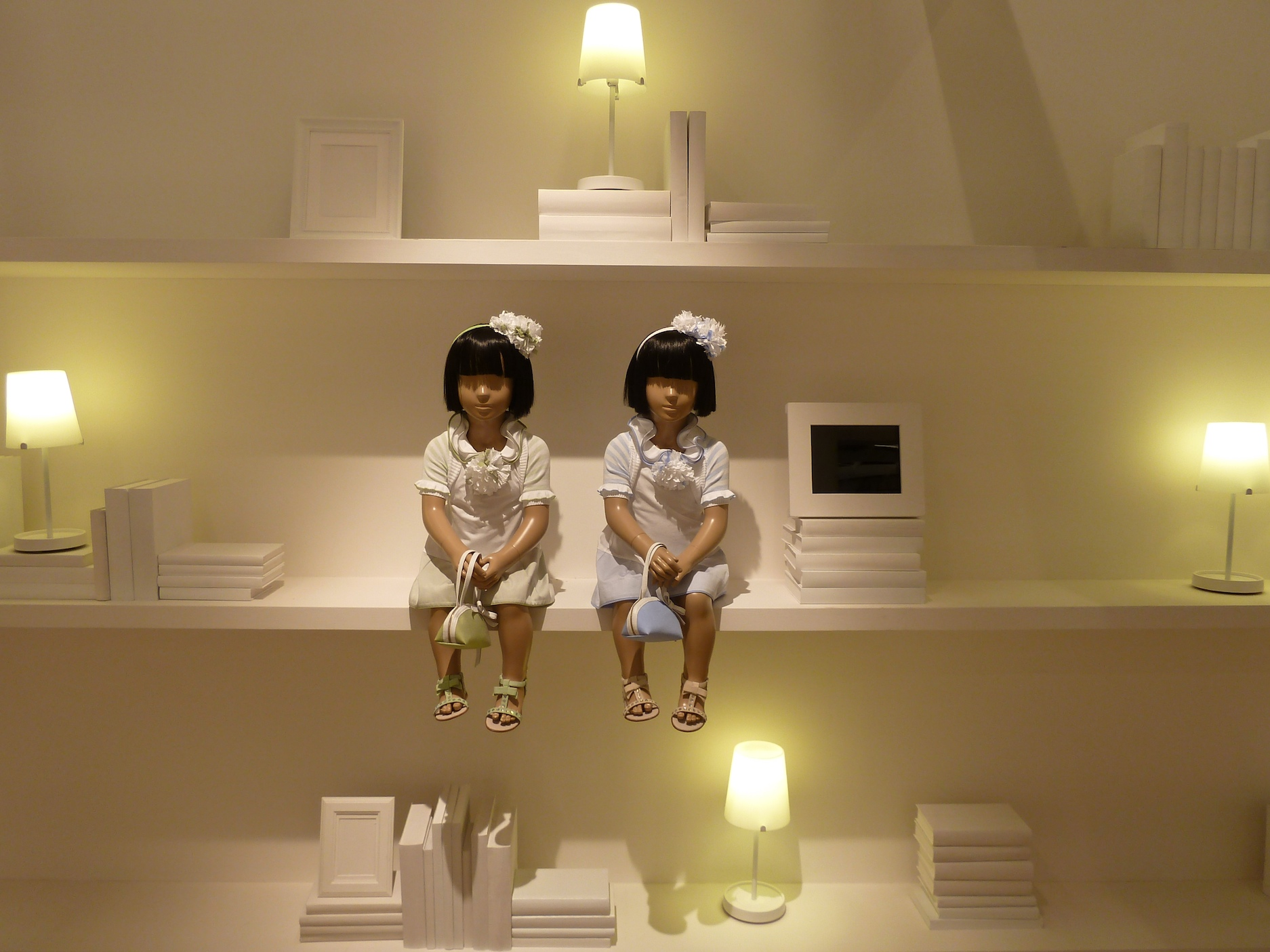 Simonetta's all white stand featuring Oriental models, kids fashion for spring 2012