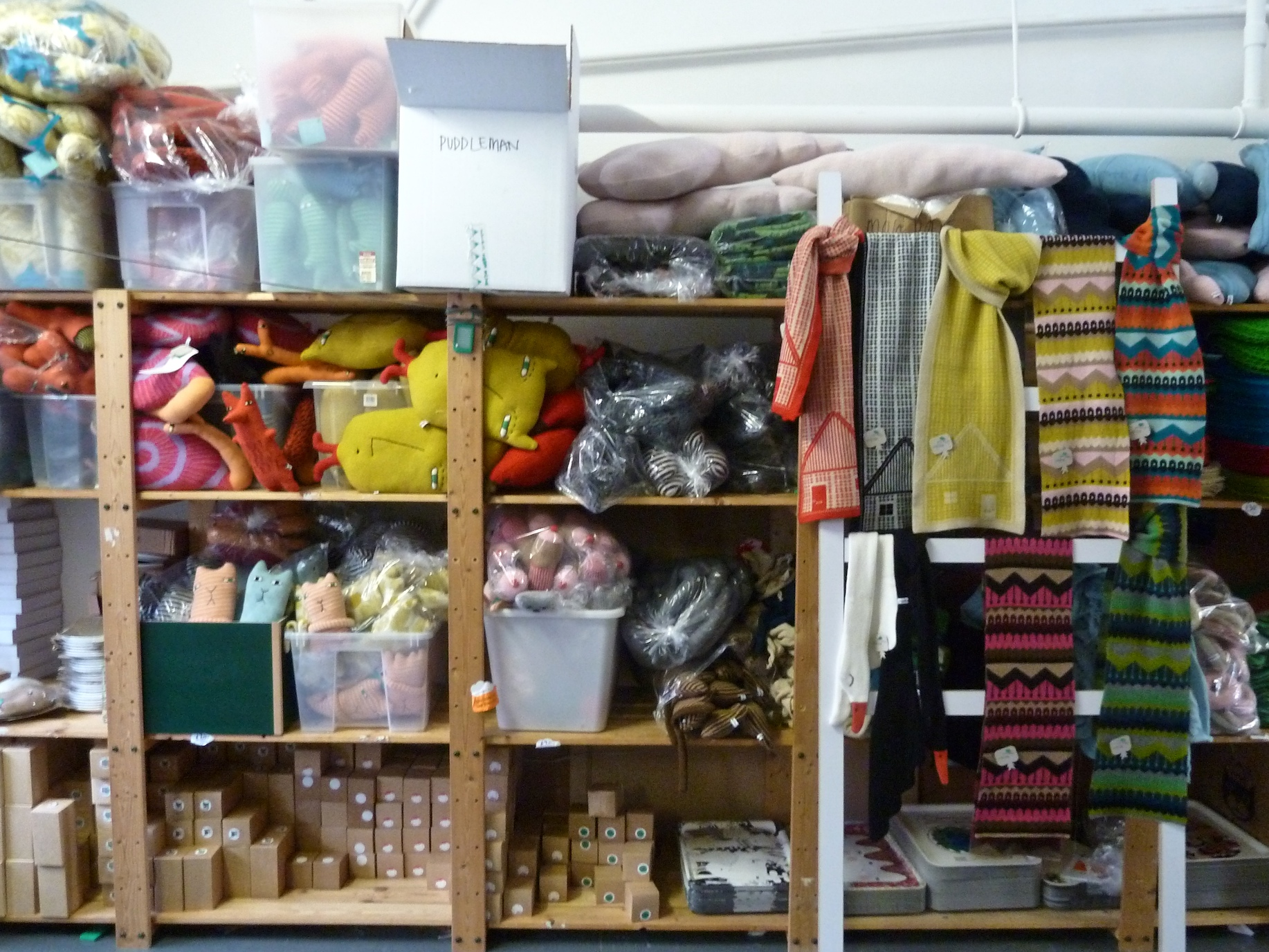 Amazing stuffed shelves and the new scarves featuring Scandinavian style houses from Donna Wilson for winter 2011