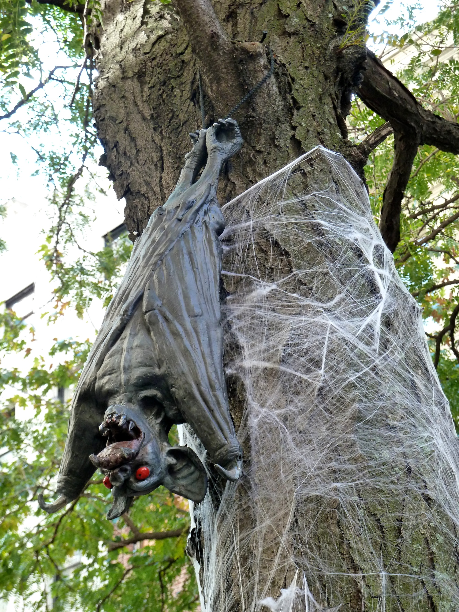 Bat decorated tree in a New York street for Halloween 2011
