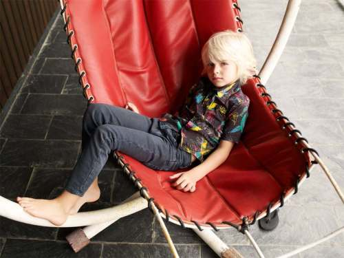 The tropical print is used for both boy's shirts and girls pants and jumpsuits at Finger in The Nose summer 2012