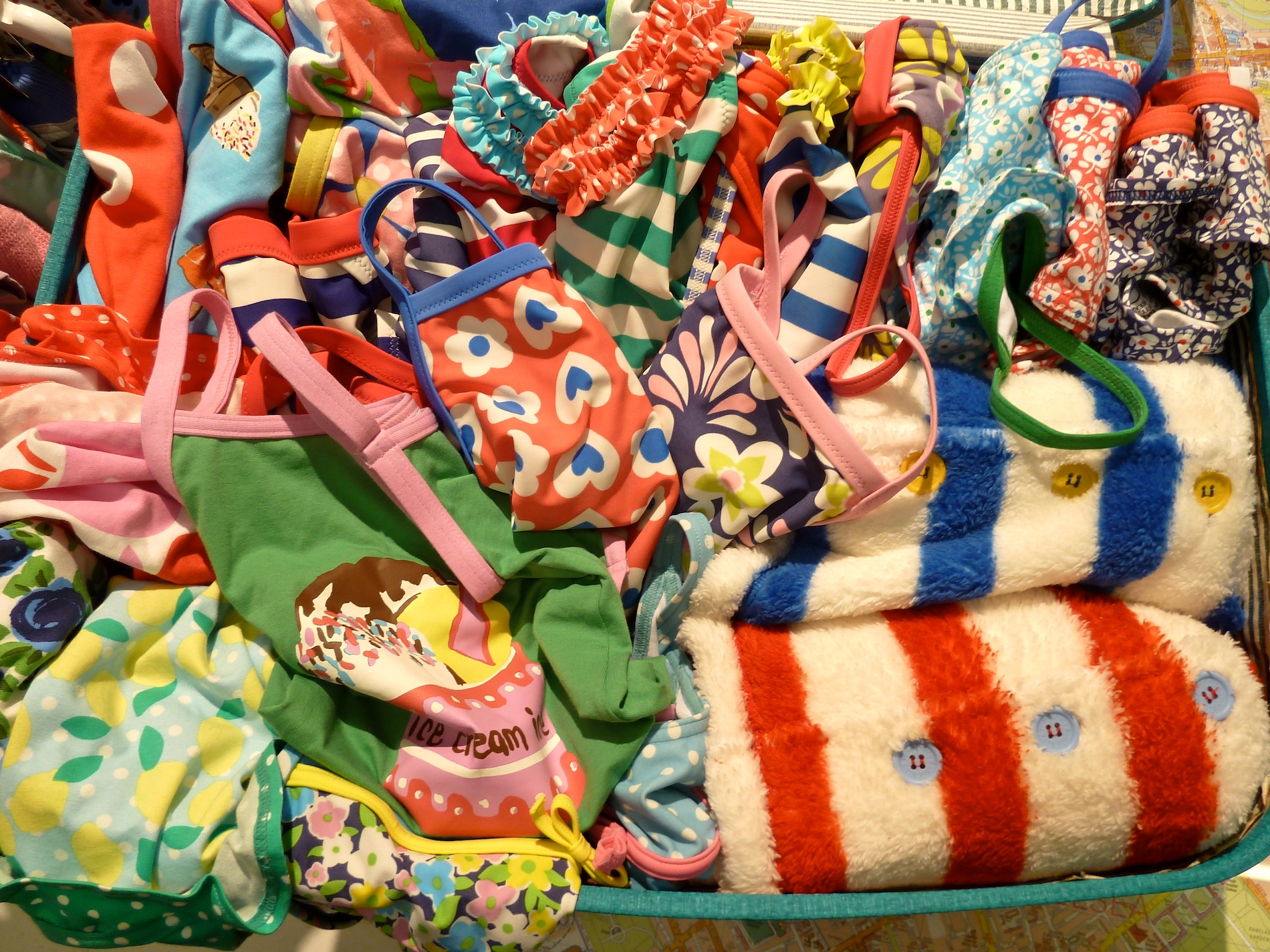 One well stuffed suitcase with Mini Boden kids swimwear and towels for summer 2012