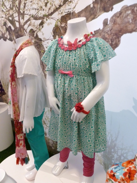 Retro floral prints have neon ribbon and lace trims at Monsoon Kids for summer 2012