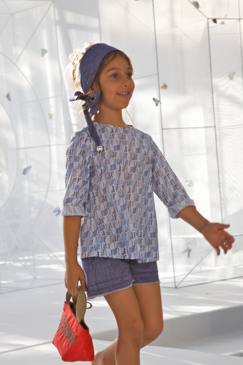 Fendi uses its classic logo for prints, logo-ed bucket bags and on shoes and scarves for kidswear summer 2012