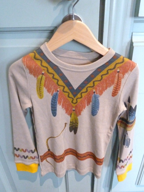 Stella McCartney went western for summer 2012 childrenswear with fringed denim shirts and tooled cowboy boots as well as the printed T-s seen here.