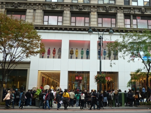 Queues and drum band at the 3rd New York store opening for Uniqlo 34th St, October 2012