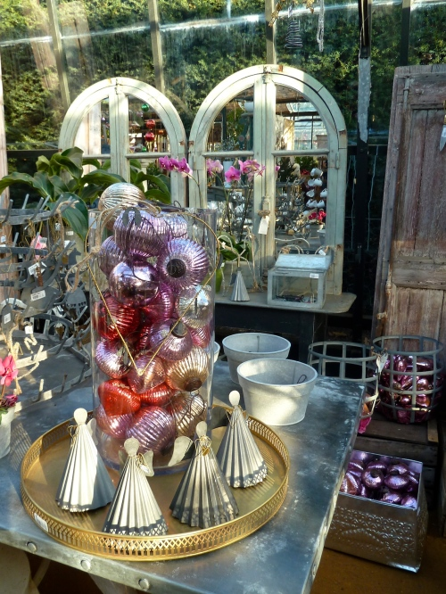 Its all about juxtapositions, pink shades of tree baubles sold next to pink orchids at Petersham Nurseries for Christmas 2011