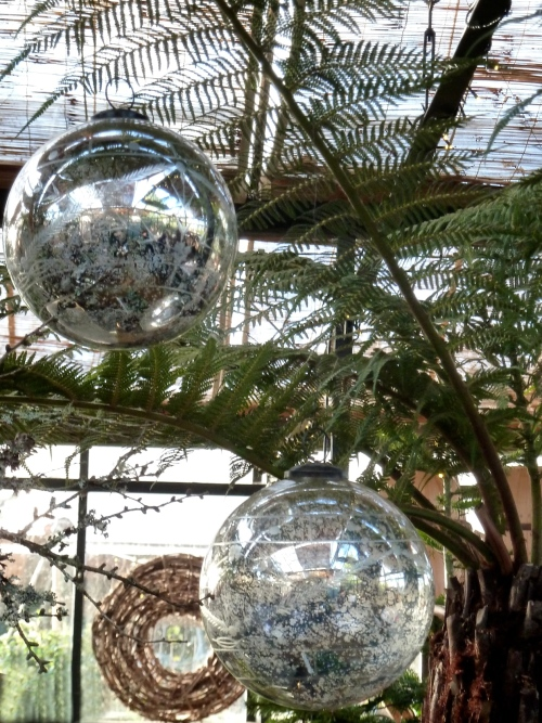 Giant decorated silver tree baubles for Christmas at Petersham Nurseries
