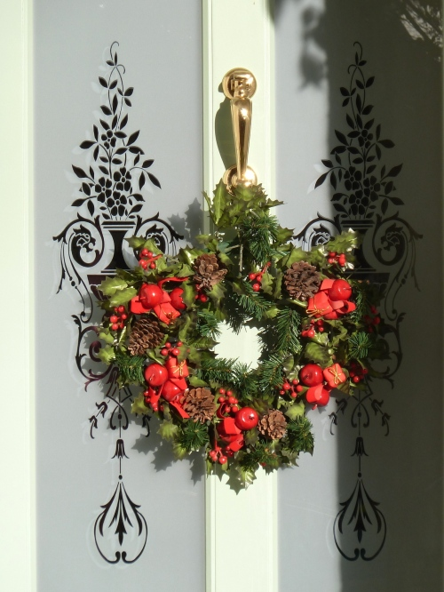 Classic red and green wreath which looks gorgeous against the frosted glass, Xmas 2012