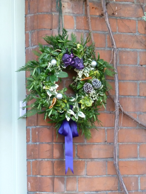 One owner's solution to the lack of a door knocker to hang the wreath from, Xmas 2011
